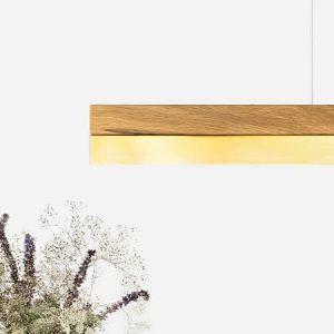 GANT lights C1 - GANTlightsC1 langwerpige hanglamp van eiken en messing. De C1 is vervaardigd uit één stuk eiken. De combinatie van messingmet licht-eikenleidt tot eentijdloosen elegantdesign. De kapvan de C1 kan te allen tijde vervangen worden door een nieuwe en/of andere (metaal-) soort.